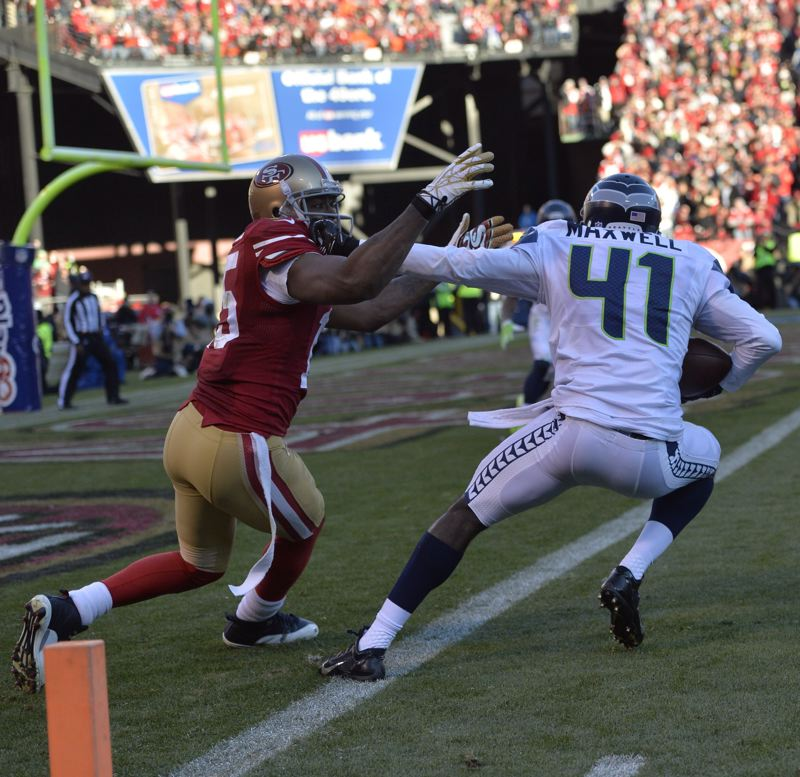 by: COURTESY OF MICHAEL WORKMAN - Seattle's Byron Maxwell starts to attempt a runback after his interception.