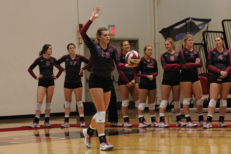 by: COURTESY PHOTO: JOSEPH EPPERSON/CENTRAL WASHINGTON UNIVERSITY - Former Century volleyball star and current Central Washington University freshman Jordan Deming prepares to serve during a match this year while her Wildcat teammates look on.