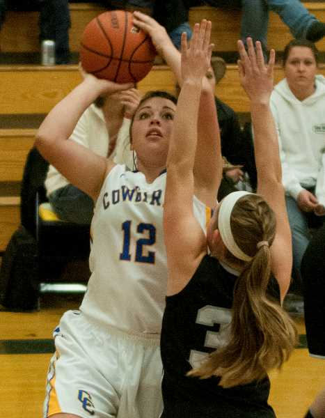by: LON AUSTIN/CENTRAL OREGONIAN - Kimmer Severance goes up for two of her game-high 24 points in the Cowgirls' victory over Sisters on Saturday night. Severance also had 12 rebounds and five steals in the contest as the Cowgirls raised their record to 2-1.