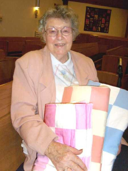 by: CLACKAMAS UCC - Betty Prible has donated thousands of quilts to her churchs outreach ministries such as the Madonna Center, the Celilo Indian Village and the Christmas Giving Tree.