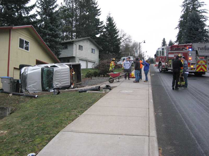 by: RAY PITZ - this wa the scene on Pine Street Monday afternoon after a car headed uphill overcorrected and ended up in the front yard of a home on the opposite side of the street.