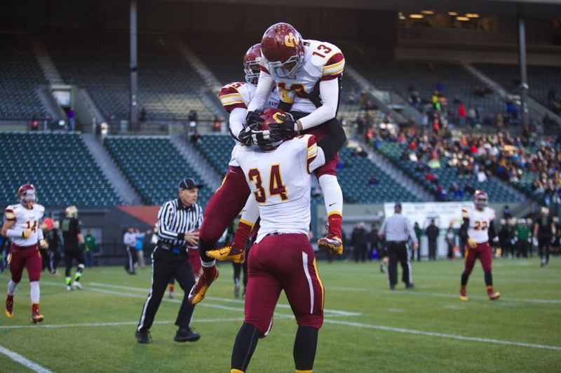 by: TRIBUNE PHOTO: JAIME VALDEZ - Central Catholic running back Ryan Nall lifts quartrerback Aidan Wilder after the QB passed to him for a 2-point conversion in Saturday's Class 6A championship victory over Jesuit.