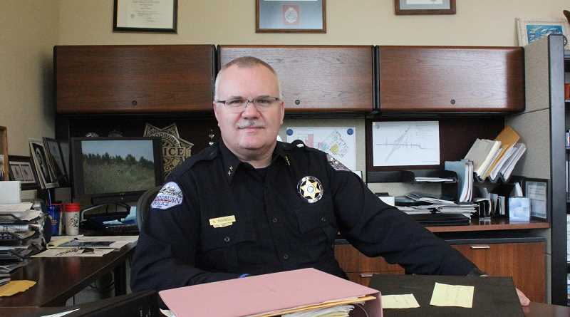 by: JEFF MCDONALD - Police Chief Scott Russell, pictured earlier this year, is battling infection in his one good leg, placing him on medical leave for an indefinite amount of time.