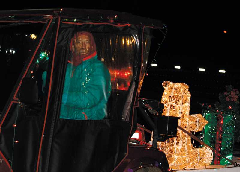 by: PHIL HAWKINS - Estates resident Stan Hiller takes his place at the front of the annual Golf Cart Parade, a position hes held in the parade for years.