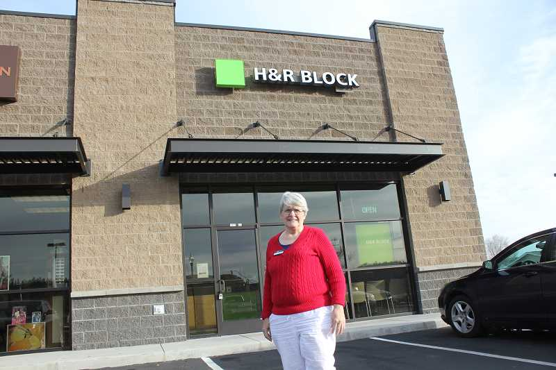 Senior tax advisor Dorothy Burgess stands outsisde the new office by Hometown Drug.