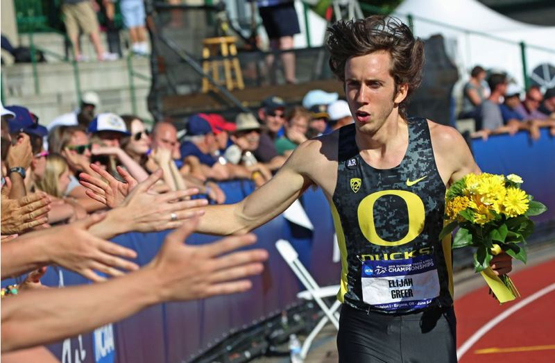 by: PAMPLIN MEDIA GROUP: MATT SHERMAN - Elijah Greer, former University of Oregon standout, celebrates a victory lap with Hayward Field fans after winning the NCAA 800-meter title in June 2013.