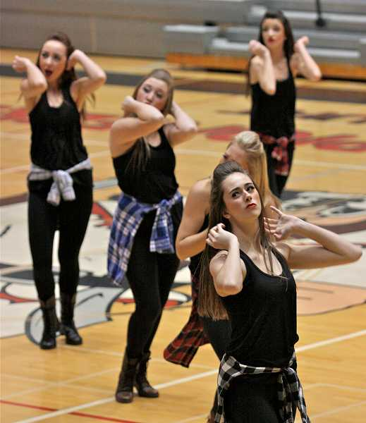 by: TIDINGS PHOTO: J. BRIAN MONIHAN - The Debs compete at the 2013 Category Championships on Dec. 7.