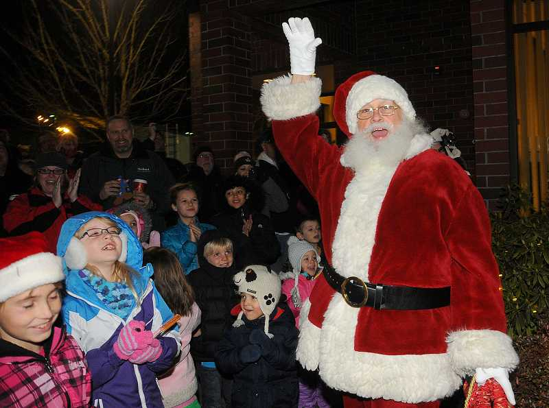 by: TIDINGS PHOTO: VERN UYETAKE - Santa does a countdown for the lighting of the tree.