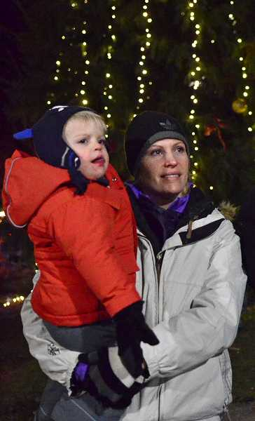 by: TIDINGS PHOTO: VERN UYETAKE - Hayley and Collin Warren check out the festivities at Friday's tree lighting.