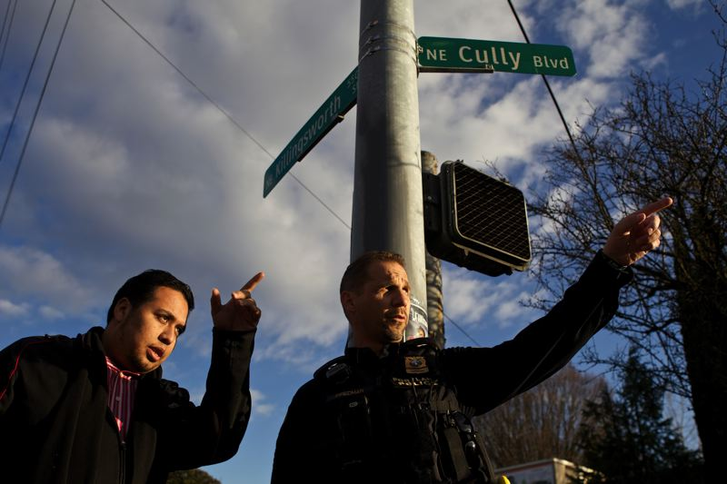 by: TRIBUNE PHOTO: JAIME VALDEZ - Juan Muros, resident services coordinator at Villa de Clara Vista apartments, shows Portland police Sgt. Mark Friedman where  gangs and graffiti used to proliferate--until police started making foot patrols.