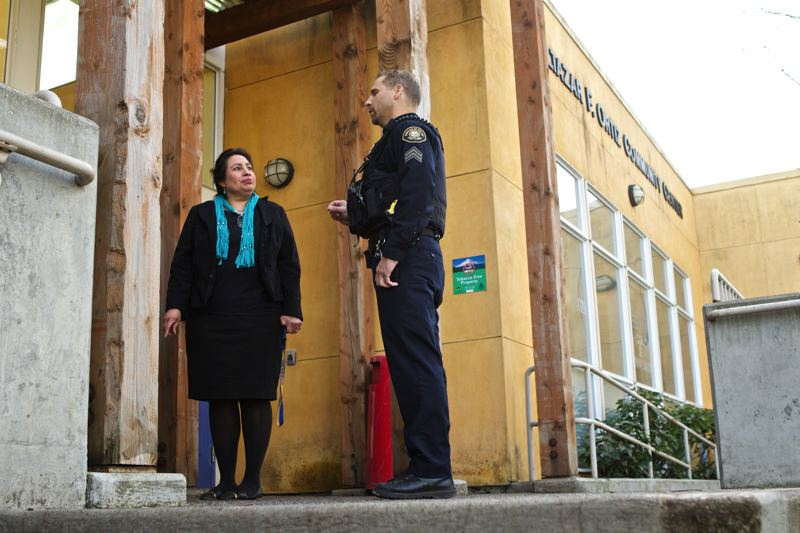 by: TRIBUNE PHOTO: JAIME VALDEZ - As part of his community policing walk, Street Crimes Unit Sgt. Mark Friedman checks in with Virginia Q. Salinas of the Bienestar Family Wellness Program on Northeast Killingsworth Street.