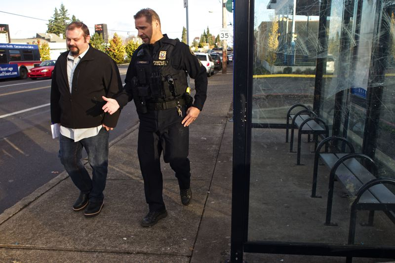 by: TRIBUNE PHOTO: JAIME VALDEZ - Sgt. Greg Stewart of Portlands Polices Crime Analysis Unit, here walking with Street Crimes Unit Sgt. Mark Friedman, has spearheaded the bureaus new community policing experiment.