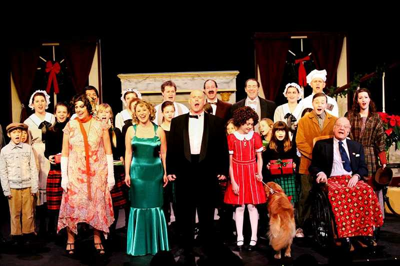 The cast of Annie belted out tunes last weekend at the opening at Theatre in the Grove.