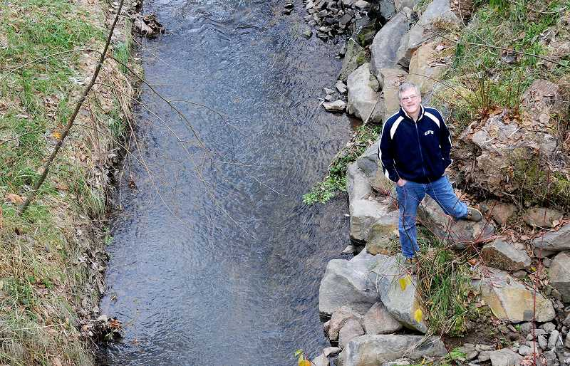 by: GARY ALLEN - Handy work - Clyde Thomas' efforts to return the portion of Hess Creek Canyon that flows through the George Fox University campus to health earned him the accolades of the YSWCD.