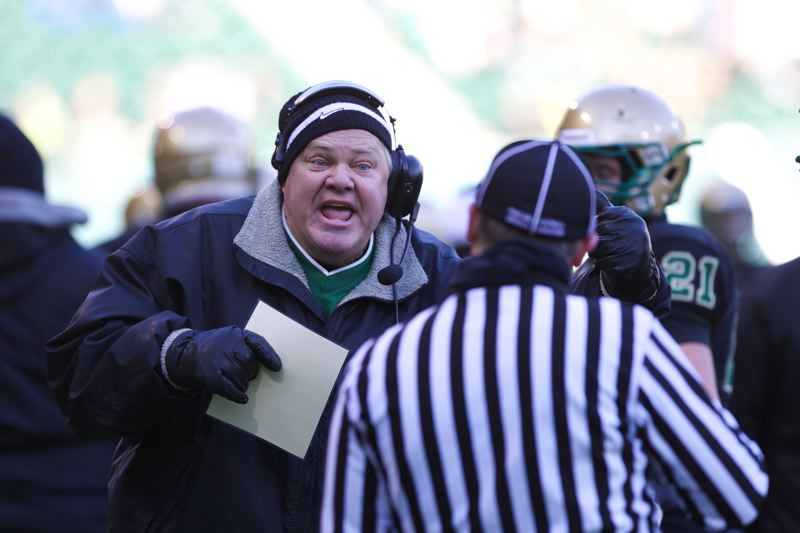 by: TIMES PHOTO: JAIME VALDEZ - Jesuit Crusaders head coach Ken Potter, above, tells a referee to watch holding against Central Catholic Rams in the 6A football championship game at Jeld-Wen Field.