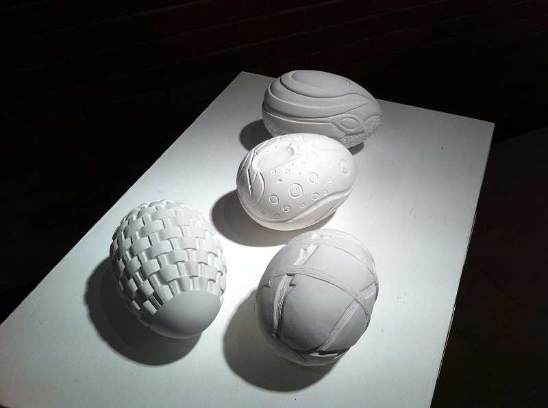 by: COLLEEN CORNISH - From a project in Basic Design class, these plaster eggs are the work of student artists Kaleb Bass, Zach Mullenax, Vy Bui and Dzn Nguyen.