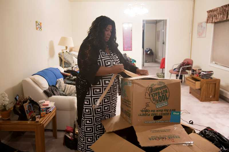 by: TIMES PHOTO: JONATHAN HOUSE - Melinda Bell unpacks her boxes Tuesday in the new women's LifeChange transitional housing facility in Beaverton. Bell is from Eastern Oregon and credits the program with turning her life around.