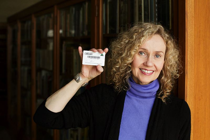 by: CONTRIBUTED PHOTO - Merris Sumrall, CEO of the Library Foundation, shows her Multnomah County library card. Sumrall recently received a Creative Leadership Award from the Paul G. Allen Foundation.