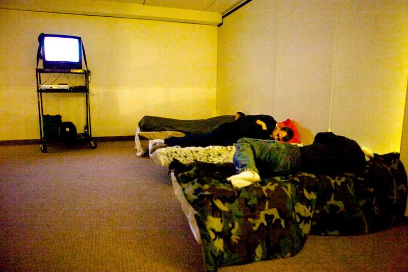 by: TIMES PHOTO: JAIME VALDEZ - Homeless people get some sleep at the First Baptist Church of Beaverton's warming shelter in 2012.