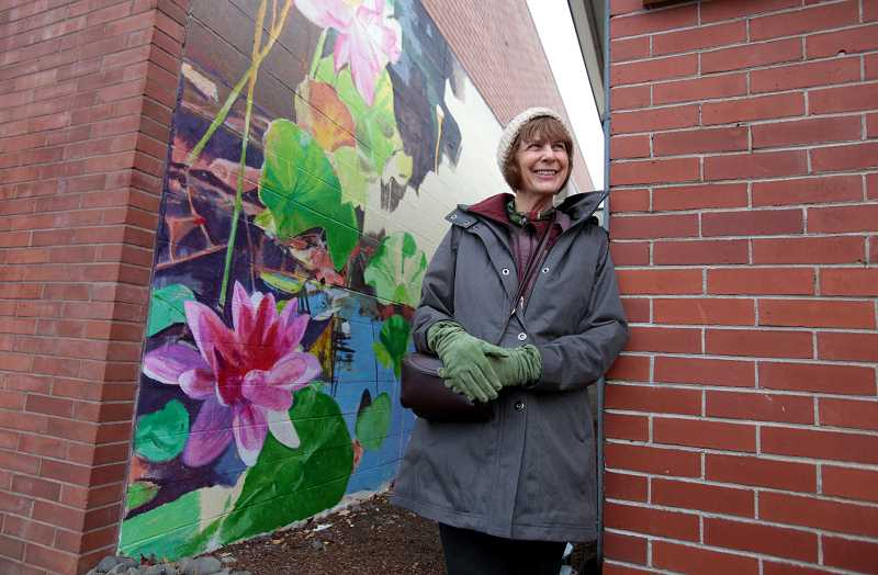 by: TIMES PHOTO: JONATHAN HOUSE - Sandy Kangas shows off the last mural her recently deceased husband, Larry, started on in downtown Beaverton.