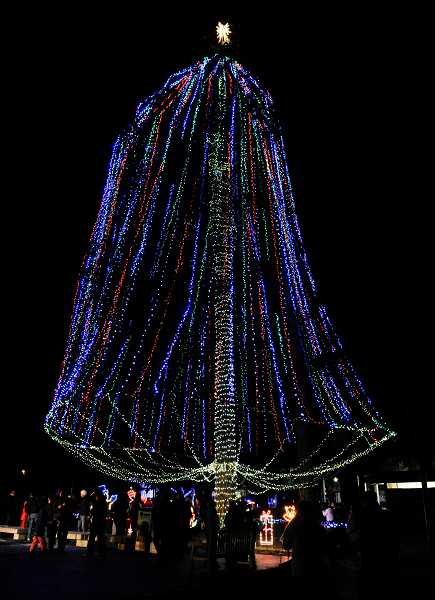 by:  TIMES PHOTO: JOHN LARIVIERE - Beaverton's holiday tree lights up Beaverton City Park.