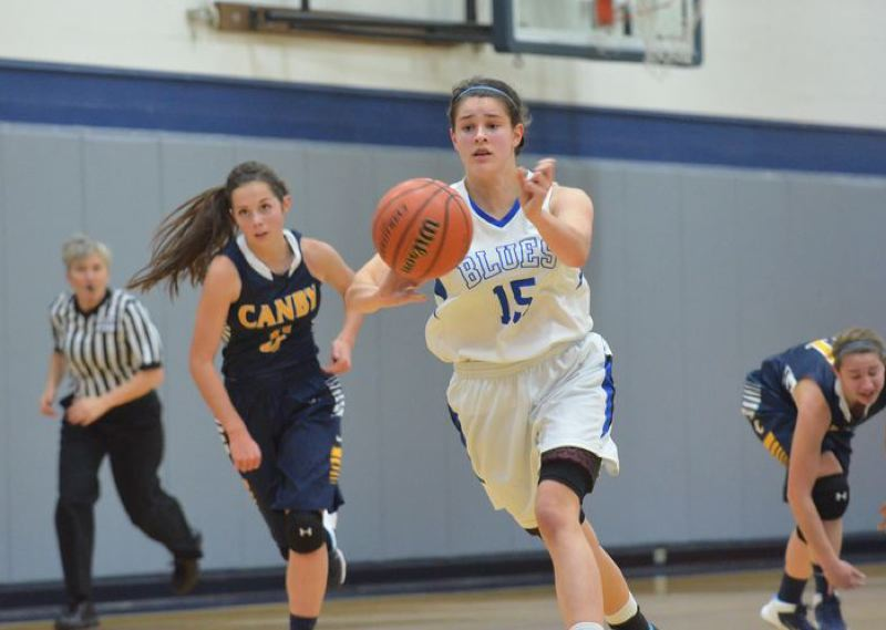 by: PAMPLIN MEDIA GROUP: JEFF GOODMAN - Clara Ell pushes the ball ahead for the St. Mary's Blues in their Tuesday victory at home over Canby.