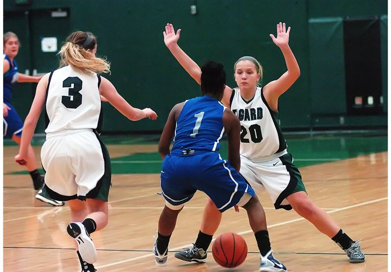 by: DAN BROOD - TRAPPED -- Grant's Princess McNair (1) has no where to go between Tigard senior Emilee Cincotta (3) and freshman Kylie Warren.