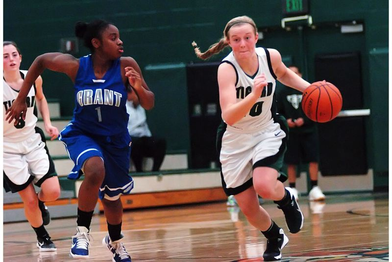 by: DAN BROOD - ON THE DRIVE -- Tigard High School junior Kaylie Boschma (right) looks to get ahead of Grant freshman Princess McNair.