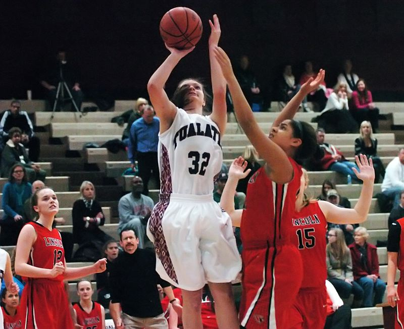 by: DAN BROOD - SURE SHOT -- Tualatin senior post Savannah Heugly (32) goes up for a shot in Tuesday's game.