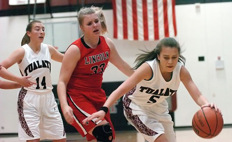 by: DAN BROOD - KEEPING CONTROL -- Tualatin High School sophomore Tamika Etherly (right) stays in charge of the action and she controls the ball in front of Lincoln sophomore Rachelle Beaudoin in Tuesday's game.