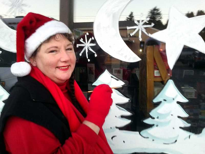 by: CONTRIBUTED - Mary Whitney paints a comissioned winter scene on a Book Nook Window, Wednesday, Dec. 4.