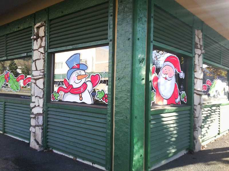 by: CONTRIBUTED - Whitney painted these Christmas critters in the vacant Safari Club windows.