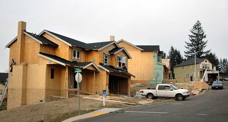 by: ISABEL GAUTSCHI - Here is just one of several houses being built above Cemetary Road.