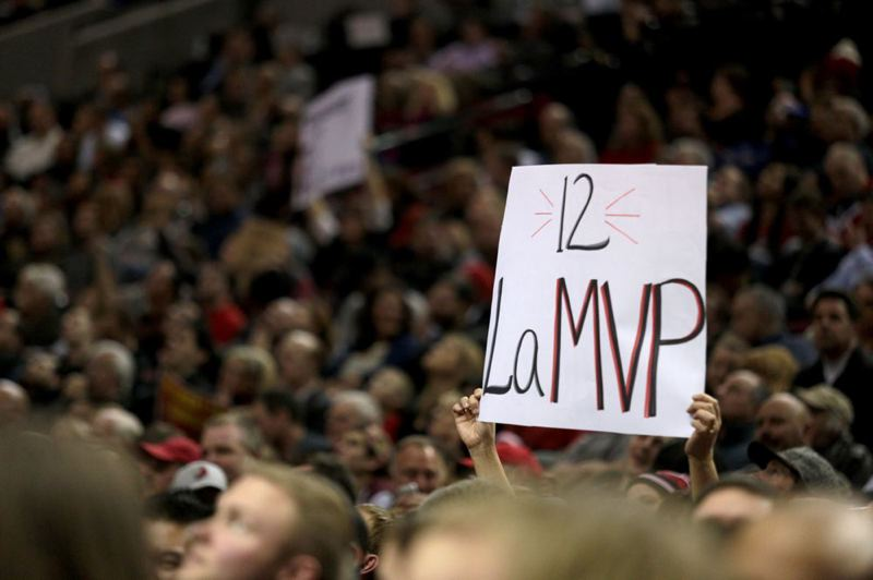 by: TRIBUNE PHOTO: JONATHAN HOUSE - A fan at Moda Center on Thursday night holds a sign endorsing Trail Blazers power forward LaMarcus Aldridge for NBA MVP honors.