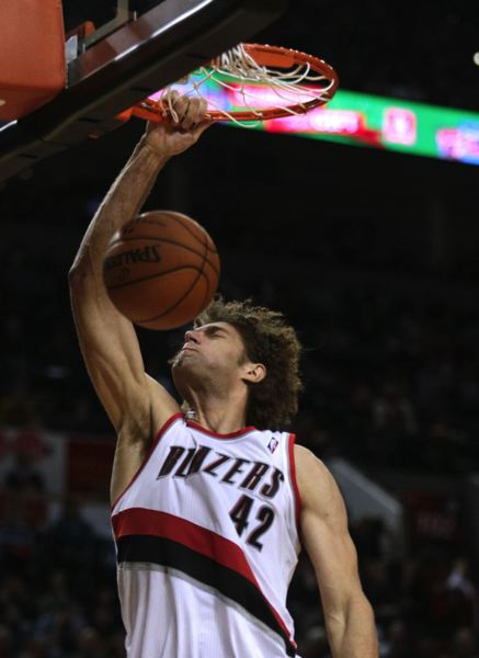 Blazers center Robin Lopez slams home two points.