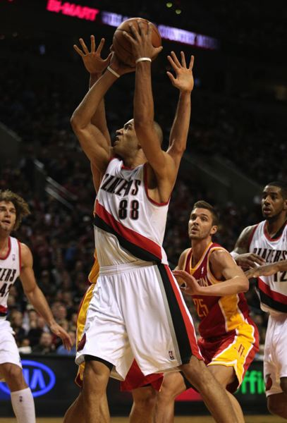 Nicolas Batum goes for an inside shot.