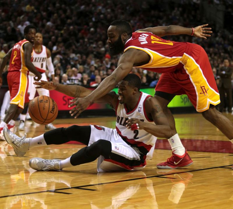Houston's James Harden tries to go over Portland's Wesley Matthews for the ball.