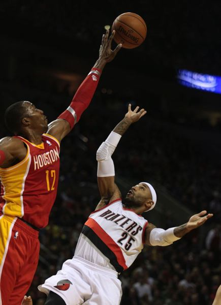 Dwight Howard blocks a shot by Portland's Mo Williams.