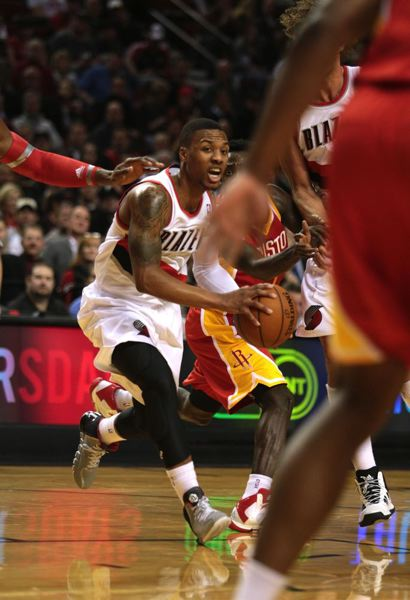 Damian Lillard looks for a lane.
