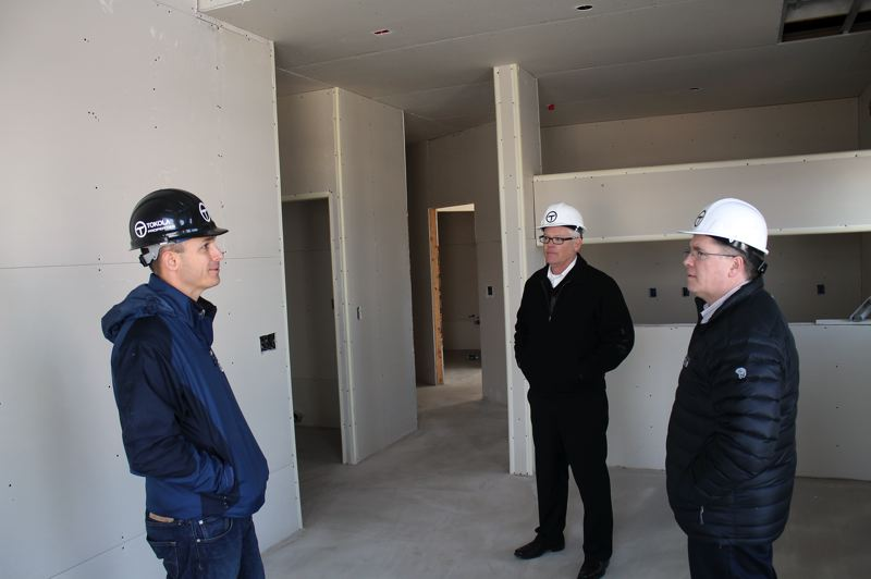 by: HILLSBORO TRIBUNE PHOTO: JOHN SCHRAG - Tokola Properties president Dwight Unti (center) and project manager Jeff Edinger (left) showed off the 4th Main building to Hillsboro planning director Colin Cooper late last month. Cooper told the Hillsboro Tribune he was impressed with the quality of the workmanship in the four-story structure.