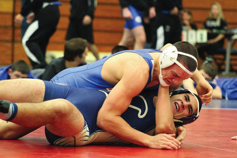 by: HILLSBORO TRIBUNE PHOTO: AMANDA MILES - Hillsboro junior T.J. Cavender pins Liberty's Javier Picard in the first period of their 195-pound match at Tuesday's nonleague wrestling dual.