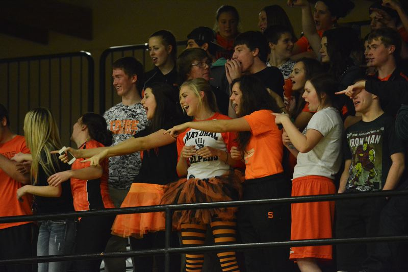 Scappoose students get vocal during the second half of the Indians' 62-49 road loss in St. Helens.