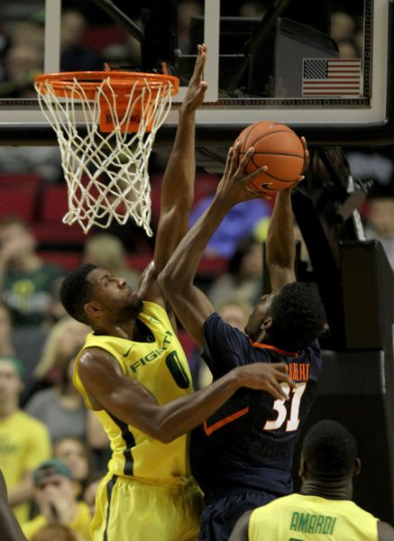 Mike Moser of Oregon goes up for a block.