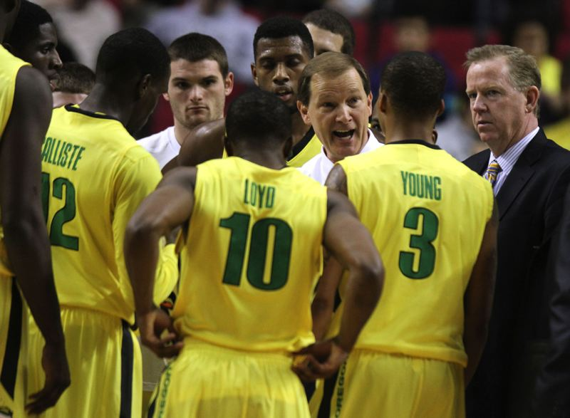 Oregon coach Dana Altman talks to his troops during a timeout.