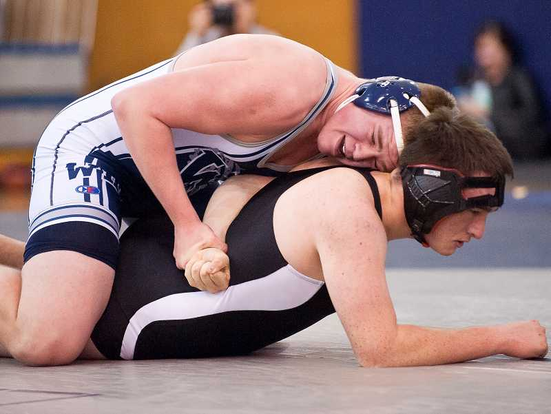 by: JOSH KULLA / FILE - Wilsonville senior Justin Hamilton took third place in the 195-pound bracket of the Rose City Championship wrestling tournament Dec. 13-14 at Westview High School in Portland.