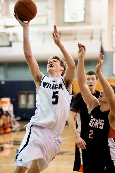 by: GREG ARTMAN - Tyler Hieb is wearing the No. 5 jersey this season, building on the Wilsonville boys basketball program's legacy of major contributors with the number.