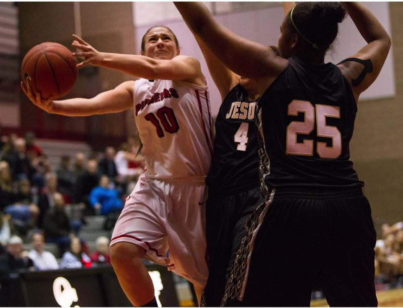 by: DAVID BLAIR - Oregon City sophomore wing Cierra Walker (10) takes the ball to the basket in the Pioneers season opener with Jesuit. Walker has been impressive in the Pioneers first three games, averaging 13 points and half a dozen assists in wins over the Crusaders, McMinnville and Tigard.