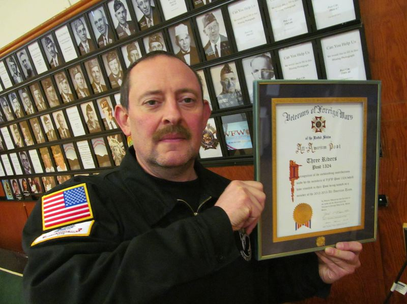 by: PHOTO BY ELLEN SPITALERI - VFW Post #1324 Commander Ken Kraft displays the All-American Post certificate given to the Oregon City-based chapter in 2012.