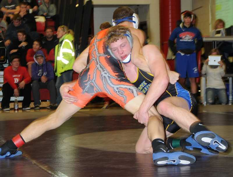 by: LON AUSTIN/CENTRAL OREGONIAN - Colbran Meeker works to control a wrestler during the Central Oregon Officials Tournament. Meeker won the tournament, and was one of four Cowboys to take first this past weekend at the Coast Classic.