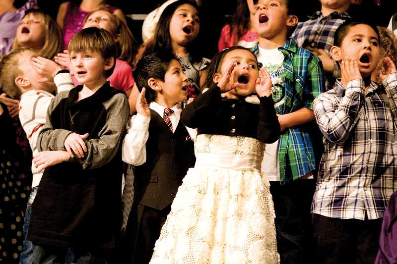 by: KEVIN SPERL - The Ochoco Elementary Bilingual Choir entertained the audience with Spanish-language renditions of 'Frosty the Snowman', 'Jingle Bells' and 'Rudolph the Red-Nosed Reindeer' as part of the Happy Christmahanakwanzaa celebration.